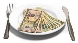 dollar (dollars) on dish with fork and knife